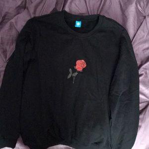 black sweatshirt with a rose